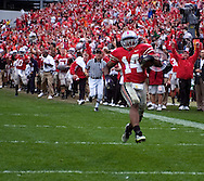 Ohio State's Antonio  Smith returns an interception for a 55-yard touchdown yesterday in the fourth quarter.