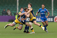 Tom Prydie  of the Newport Gwent Dragons tries to find the gap between Val Rapava Ruskin (L) and Ryan Mills (r) of the Worcester Warriors with Ashton Hewitt of the Newport Gwent Dragons looking on. EPCR Challenge cup rugby match, pool 3, Worcester Warriors v Newport Gwent Dragons at the Sixways Stadium in Worcester, England on Saturday 10th December 2016.<br /> pic by  Simon Latham, Andrew Orchard sports photography.