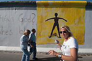 The longest part of the wall still standing is called the East Side Gallery, because the east side there are  works. of  young artists.