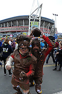 two rugby fans pose outside the stadium. Rugby World Cup 2015 pool A match, Australia v Fiji at the Millennium Stadium in Cardiff, South Wales  on Wednesday 23rd September 2015.<br /> pic by  Andrew Orchard, Andrew Orchard sports photography.