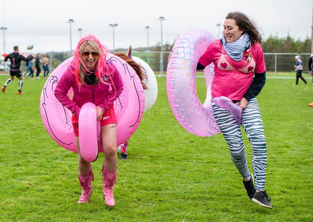 """REPRO FREE<br /> Sandra Gunning and Clare O'Connell from the Pink Ladies Ballincollig racing their inflatable mascots pictured at the 30th Anniversary Heineken Kinsale 7s at the weekend. <br /> Picture. John Allen<br /> <br /> PRESS RELEASE<br /> For Immediate Release: <br /> <br /> 30th ANNIVERSARY HEINEKEN KINSALE 7s KICKS OFF<br /> The Heineken Kinsale 7s take place in Kinsale over the May Bank Holiday weekend, 5th & 6th May 2018. This is Ireland's largest rugby 7s tournament and builds on its success each year, with over 8,000 visitors expected in the Cork seaside town.<br /> The Heineken Kinsale 7s promises to be an action-packed weekend of competitive men and women's running rugby for an attractive prize fund, trophies and medals. A high calibre of rugby players across all competitions is anticipated as well as a fun social programme. <br /> Mens Elite Champions, Projecx Waterboys from Scotland return to Kinsale to defend their title. They will compete against the Swedish Men's 7s, Speranza 22 from Dubai, The Camarthen Warriors and Ponty Butchers from Wales, CLIC Sargent Godfathers from London and University College Dublin.<br /> In Men's Open competition, The King Prawns from London are defending their title against challengers Fuze 7s, Session Motts and DISCO Bals will be challenging defending champions <br /> Former Irish International, Tania Rosser returns as player/manager for the WRR Ravens invitational side who will be looking forward to challenging The Ponty Butchers Women's team from Wales, contenders in the women's elite competition sponsored by Hayes Caravan Services.  Other women's teams include Team Boom, The All Craics, Capsized and the Ballincollig Pink Ladies who enjoy the women's social competition.<br /> Pat Maher, Event and Sponsorship Manager, Heineken Ireland said: """"We are delighted to continue our support and sponsorship of the Heineken Kinsale 7s and look forward to celebrating the 30th Anniversary in Kinsale with top-quality competitive"""
