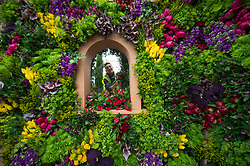 Becky Frost makes the final floral arrangements on the Marks and Spencer display during preparations for the RHS Chelsea Flower Show 2017 at the Royal Hospital Chelsea in London.
