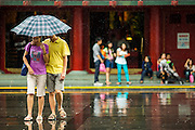 16 DECEMBER 2012 - SINGAPORE, SINGAPORE:  People use umbrellas to protect them from the rain during a downpour in the Chinatown section of Singapore.     PHOTO BY JACK KURTZ