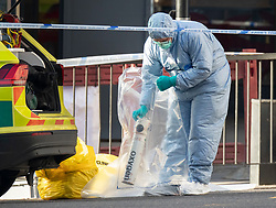 © Licensed to London News Pictures. 30/11/2019. London, UK. A forensics officer puts an oxygen cylinder in an evidence bag on London Bridge. Two people were killed and three injured after the attacker, named by police as 28-year-old Usman Khan stabbed a man and a woman to death on London Bridge. Photo credit: Peter Macdiarmid/LNP