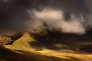 Winner - Honourable Mention in 10th (2017) International Colour Awards (Nature category) <br /> <br /> The huge & imposing massif of Yr Wyddfa (Snowdon) Wales' highest mountain. This was taken following a last minute decision to slog up Mynydd Mawr under inclement weather but it resulted in just the most fantastic hour of weather-watching from it's summit. I was utterly gripped by the continual theatrical change of light being played out across the Snowdonia hills. If it were not for my friend feeling frozen I would have braved another hour or so of just sitting and watching.