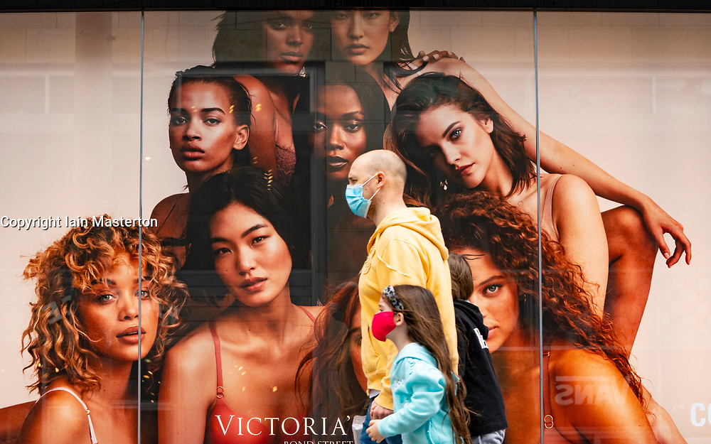 Glasgow, Scotland, UK. 17 July, 2020.  Images from Glasgow city centre as covid-19 restrictions are relaxed and  the public are out and about shopping and at work. Pictured; Public wearing face coverings walk past shop window of Victoria's Secret.  Iain Masterton/Alamy Live News