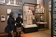 Photo ©Suzi Altman 12/5/17 Jackson,MS Pamela D.C. Junior, Director of the Mississippi Civil Rights Museum, right,  gives Judy Meredith, James Meredith's  wife a private tour of the museum before its official opening on Saturday Dec. 9th.  Pictued is a KKK, Klu Klux Klan robe on dislay, in the new Mississippi Civil Rights Museum, the robe and mask were found in a Jackson MS. home. President Trump is expected to attend the opening of the Mississippi Civiil Rights and History Museums. Protests are planned in response to President Trumps announced attendance of the opening of the Civil Rights Museum. Photo©SuziAltman