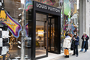 Shopping queue outside the Louis Vuitton store in the upmarket area of Knightsbridge on 14th April 2021 in London, United Kingdom. Knightsbridge is one of the principal areas for exclusive, luxury goods in West London. It is known as a district where the rich and wealthy shop, mostly for high end fashion and jewellery.