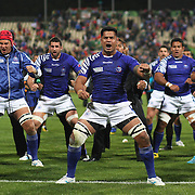 The Samoan team performing the Manu Siva Tau, a Samoan war dance, to their fans after the South Africa V Samoa, Pool D match during the IRB Rugby World Cup tournament. North Harbour Stadium, Auckland, New Zealand, 30th September 2011. Photo Tim Clayton...