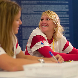 National Pro Fastpitch softball players Amy Kyler (cq), right, and Danielle Cox (cq), left, sign autographs during the 2007 DHL All-Star FanFest, Saturday, July 7 at Moscone Center West in San Francisco...Photo by David Calvert/MLB.com
