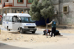 April 30, 2019 - Rafah, Palestine - Palestinian municipal workers at the Rafah refugee camp in the southern Gaza Strip, at May 1 World Workers' Day, on April 30, 2019. Photo by Abed Rahim Khatib/NurPhoto  (Credit Image: © Abed Rahim Khatib/NurPhoto via ZUMA Press)