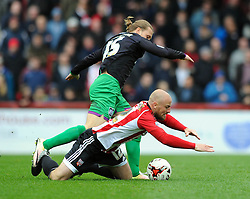 Luke Freeman of Bristol City fouls Alan McCormack of Brentford - Mandatory by-line: Dougie Allward/JMP - 16/04/2016 - FOOTBALL - Griffin Park - Brentford, England - Brentford v Bristol City - Sky Bet Championship