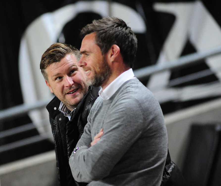 Milton Keynes Dons manager Karl Robinson (left) chats to Fleetwood Town manager Graham Alexander (right) before kick off<br /> <br /> Photographer Andrew Vaughan/CameraSport<br /> <br /> Football - The Football League Sky Bet League One - Milton Keynes Dons v Fleetwood Town - Tuesday 21st October 2014 - Stadium:mk - Milton Keynes<br /> <br /> © CameraSport - 43 Linden Ave. Countesthorpe. Leicester. England. LE8 5PG - Tel: +44 (0) 116 277 4147 - admin@camerasport.com - www.camerasport.com