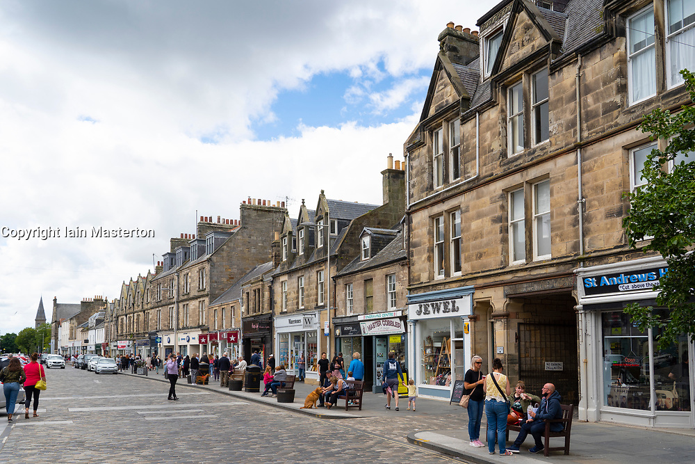 View of shops along Market Street in central St Andrews , Scotland, UK