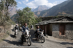Bear Haughton alongside Beanre (Kevin Doebler) with the Annapurna Range in the background on Day-7 of our Himalayan Heroes adventure riding from Tatopani to Pokhara, Nepal. Monday, November 12, 2018. Photography ©2018 Michael Lichter.