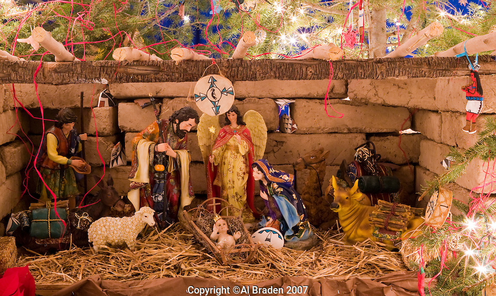 Chisrtmas Eve with manger scene with elements of Tigua Pueblo designs at Ysleta Mission in El Paso, Texas.