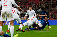 Bobby Wood of USA and Fabian Delph of England scamble for the ball during the International Friendly match between England and USA at Wembley Stadium, London, England on 15 November 2018.