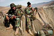 Afghan National Army soldiers rest moments before an engagement with Afghan insurgents.