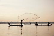 Fishermen cast nights on the Irrawaddy River, near Mandalay, Myanmar
