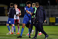 AFC Wimbledon midfielder Tyler Burey (32) shaking hands with AFC Wimbledon manager Neal Ardley during the EFL Trophy group stage match between AFC Wimbledon and Stevenage at the Cherry Red Records Stadium, Kingston, England on 6 November 2018.