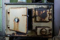 Old stove inside derelict croft house, Berneray, Outer Hebrides, Scotland