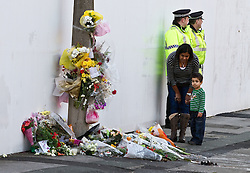 © Licensed to London News Pictures. 06/01/2012. Salford, UK. THe parents of Anuj Bidve, who was murdered on Boxing Day in Salford, attend the scene of the crime, where a memorial shrine of flowers, candles and messages has been built. 20 year old Kiaran Stapleton of Regent Square, Ordsall, Salford, has been charged with Mr Bidve's murder. Photo credit : Joel Goodman/LNP
