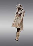 Ancient Egyptian statue of Ramesses II , granite, New Kingdom, 18th Dynasty, (1500-1400 BC, Karnak, Temple of Mut. Egyptian Museum, Turin. Grey background.<br /> <br /> The statue depicting Ramesses II  was reworked over a statue of an earlier pharaoh. This can be seen around the corners of the mouth which show reworking. The roundness of the face and short apron also point to an earlier style.  Ramesses II is depicted praying with his arms out straight and his hands resting flat on the apron of his kilt. .<br /> <br /> If you prefer to buy from our ALAMY PHOTO LIBRARY  Collection visit : https://www.alamy.com/portfolio/paul-williams-funkystock/ancient-egyptian-art-artefacts.html  . Type -   Turin   - into the LOWER SEARCH WITHIN GALLERY box. Refine search by adding background colour, subject etc<br /> <br /> Visit our ANCIENT WORLD PHOTO COLLECTIONS for more photos to download or buy as wall art prints https://funkystock.photoshelter.com/gallery-collection/Ancient-World-Art-Antiquities-Historic-Sites-Pictures-Images-of/C00006u26yqSkDOM