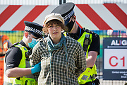 Hertfordshire Police arrest an environmental activist from HS2 Rebellion who, together with another activist, had used a lock-on arm tube to block a gate to the South Portal site for the HS2 high-speed rail link on 14 September 2020 in West Hyde, United Kingdom. Anti-HS2 activists blocked two gates to the same works site for the controversial £106bn rail line, one remaining closed for over six hours and another for over twelve hours.