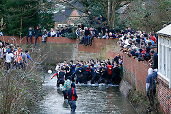 © Licensed to London News Pictures. 09/02/2016. Ashbourne, UK. Rival teams 'Up'ards' and 'Down'ards' battle for the ball during the first day of the Royal Shrovetide Football match in Ashbourne, Derbyshire. For two days, over Shrove Tuesday and Ash Wednesday, hundreds of participants battle it out in a 'no rules' game dating back to the 17th Century where the aim is to get a ball into one of two goals that are positioned three miles apart at either end of Ashboune. Photo credit: Tolga Akmen/LNP