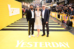 Himesh Patel (left), Lily James and Danny Boyle (right) attending the Yesterday UK Premiere held in London, UK.