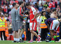 Football - 2016 / 2017 Premier League - Arsenal vs. Everton<br /> <br /> A dejected Mesut Ozil of Arsenal after failing to qualify for the Champions League after the match at The Emirates.<br /> <br /> COLORSPORT/ANDREW COWIE