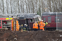 © Licensed to London News Pictures . 23/01/2013 . Manchester , UK . A derailed train on a busy stretch of track between Manchester and Salford today (23rd January 2013) . The accident has closed many major commuter routes adjacent to the track including the city's A57M Regent Road . Photo credit : Joel Goodman/LNP