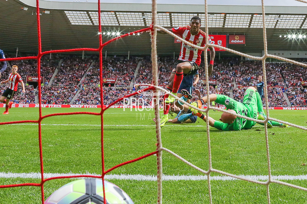 Sunderland defender Patrick van Aanholt (3) scores a goal and celebrates to make the score 1-2 during the Premier League match between Sunderland and Middlesbrough at the Stadium Of Light, Sunderland, England on 21 August 2016. Photo by Simon Davies.