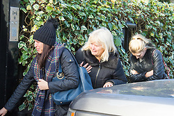 Highgate, London, December 26th 2016. Fans gather outside the London home of pop icon George Michael who died on Christmas day. PICTURED: Tearful women outside the London home of the late George Michael.