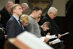 © Licensed to London News Pictures. 21/11/2016. Birmingham, UK. A service of prayer to mark the deaths of 21 people killed in the Birmingham Pub bombings on the 42nd anniversary. Pictured, families stand together during prayers. credit: Dave Warren/LNP