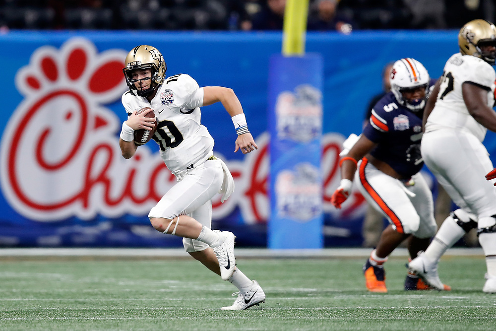 UCF Knights quarterback McKenzie Milton (10) runs the ball during the 2018 Chick-fil-A Peach Bowl NCAA football game on Monday, January 1, 2018 in Atlanta. (Paul Abell / Abell Images for the Chick-fil-A Peach Bowl)