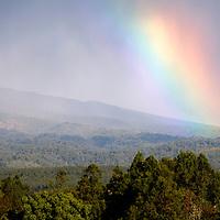 Africa, Kenya, Nanyuki. Rainbow over the landscape of Mt. Kenya Safari Club.