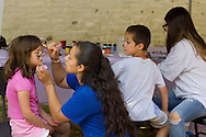 Middletown, New York - Children get their faces painted at the Middletown YMCA Funzone during the Orange Regional Medical Center's Run 4 Downtown road race on Aug. 16, 2014.