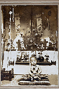 1915 severely deteriorating image of Japanese little boy in front of boys day decoration display