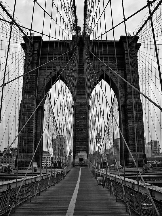 View of one the Brooklyn Bridge towers from the pedestrian walkway over the East River in New York City.