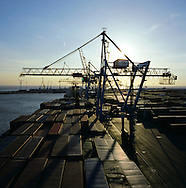 A container ship loading cargo at the Royal Seaforth Dock on the Mersey in Liverpool. The Mersey is a river in north west England which stretches for 70 miles (112 km) from Stockport, Greater Manchester, ending at Liverpool Bay, Merseyside. For centuries, it formed part of the ancient county divide between Lancashire and Cheshire.