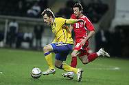 Tobias Hysen of Sweden breaks away from Simon Davies of Wales. International friendly, Wales v Sweden at the Liberty Stadium in Swansea on Wed 3rd March 2010. pic  by  Andrew Orchard