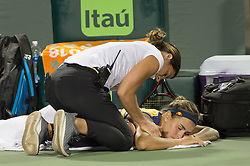 March 26, 2018 - Key Biscayne, FL, U.S. - KEY BISCAYNE, FL - MARCH 26: Monica Puig (PUR) receives medical treatment at the 2018 Miami Open on March 24, 2018 at the Tennis Center at Crandon Park in Key Biscayne, FL. (Photo by Andrew Patron/Icon Sportswire) (Credit Image: © Andrew Patron/Icon SMI via ZUMA Press)