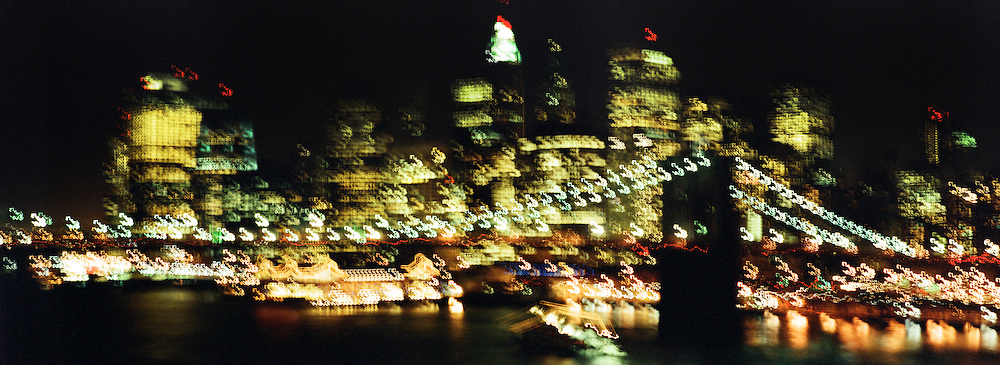 A Panoramic view of Downtown Manhattan at night showing the Brooklyn Bridge in New York, USA. 23rd July 2011. Photo Tim Clayton