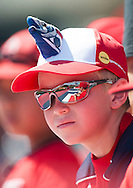 A young Angel fan looks for autographs before the Angels' preseason game against the Chicago Cubs at Angel Stadium Sunday.