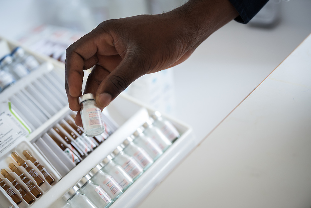 2 March 2017, Ma Mafefooane Valley, Lesotho: Dr N. G. Suaka at work at Saint Joseph's Hospital. Here, inspecting available drugs from the drug trolley of injectable drugs. Saint Joseph's Hospital is a district hospital in the Ma Mafefooane Valley in Lesotho. The hospital was established in 1937 and is run as a Roman Catholic non-profit institution by the Christian Health Association of Lesotho. As a district hospital, it offers comprehensive healthcare including male, female, paediatric, Tuberculosis and maternity care. It is closely linked with the neighbouring Roma College of Nursing, which runs on similar premises as part of the same institution. Drug supplies are secured to the hospital by means of a Memorandum of Understanding with the government.