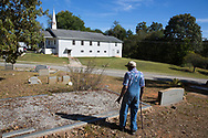 Cecil Dorsey visits a family cemetary in White County, Georgia.