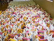 06 APRIL 2020 - DES MOINES, IOWA: Bags of food ready for distribution during a drive through emergency food distribution at First DSM Church in Des Moines. On Monday, 06 April, Iowa reported 946 confirmed cases of the Novel Coronavirus (SARS-CoV-2) and COVID-19. There have been 25 deaths attributed to COVID-19 in Iowa. Most non-essential businesses are closed until 30 April. Well over 100,000 Iowans filed first time claims for unemployment in the last three weeks, more than applied during the peak of the Great Recession of 2008. Local food banks have seen an equal spike in people seeking nutritional assistance. First DSM Church has increased their food pantry from one day weekly to three days per week. Hundreds of people lined up Monday to get a box of food and one roll of toilet paper at the church's drive through pantry.          PHOTO BY JACK KURTZ