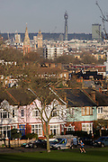 With Westminster in the distance, a male jogger runs through his local park in the London Borough of Lambeth.