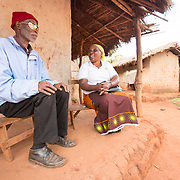 CAPTION: Living in Mozambique's Niassa Province, Casimiro Aduwa Caisse is a small business owner who lost his sight at the age of 18. Caisse struggled to find his feet after his impairment, which left him unable to continue with his work. The struggle endured until he found the Association of Blind and Partially Sighted People (ACAMO) in 2002. His involvement with this organisation gave him a new lease of life, and he devoted himself to this. Over the years, he has risen to become ACAMO's Second Provincial Delegate. Anissa Binamur, seen visiting him here, is the Provincial Delegate. LOCATION: Nzinje Village, Lichinga, Niassa Province, Mozambique. INDIVIDUAL(S) PHOTOGRAPHED: Casimiro Adua Caisse (left) and Anissa Bernado Binamur (right).